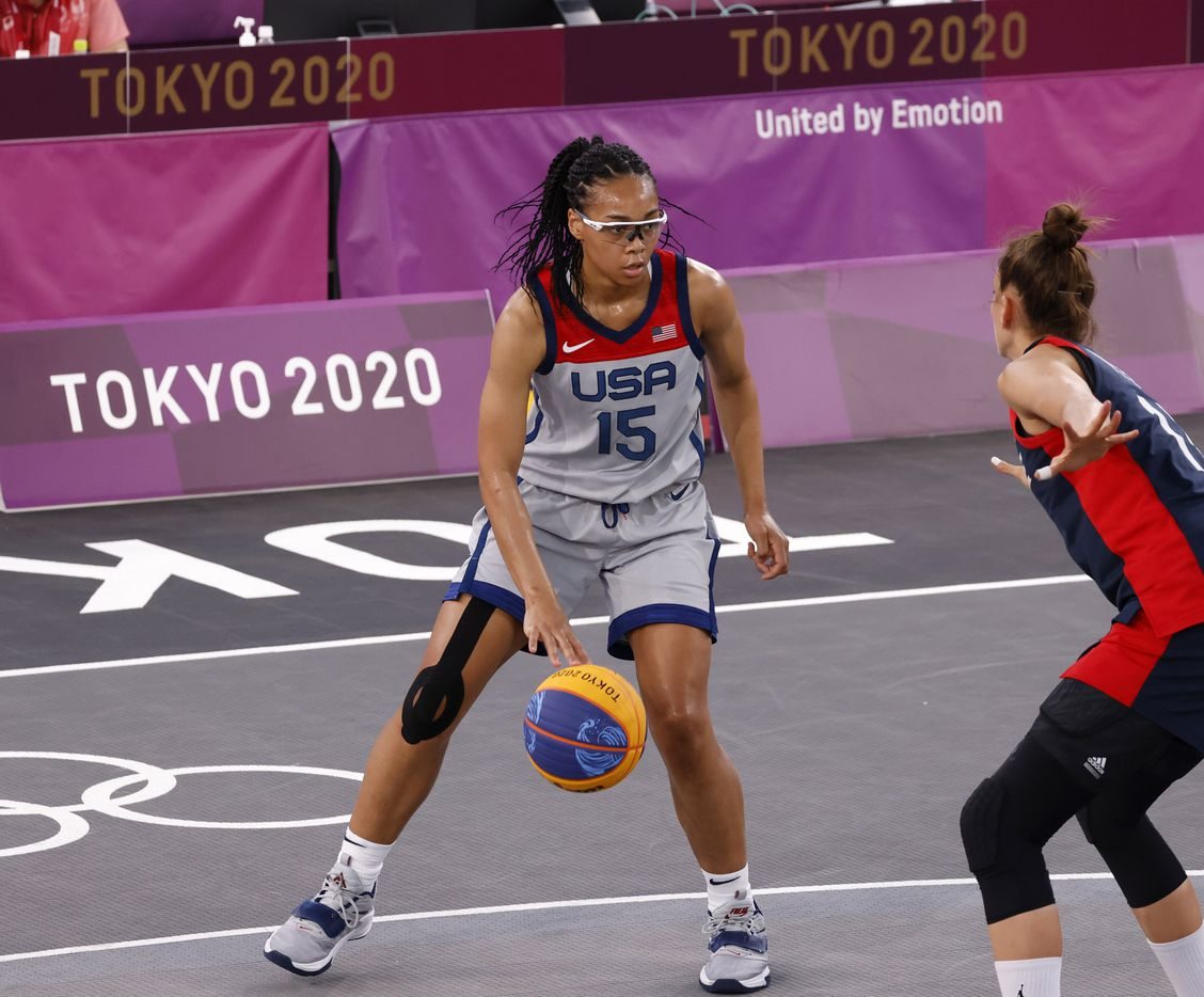 USA's Allisha Gray (15) dribbles in front of France's Ana Maria Filip (11) in a 3x3 women's basketball game during the postponed 2020 Tokyo Olympics at Aomi Urban Sports Park on Saturday, July 24, 2021, in Tokyo, Japan. USA defeated France 17-10 in the game. (Vernon Bryant/The Dallas Morning News)