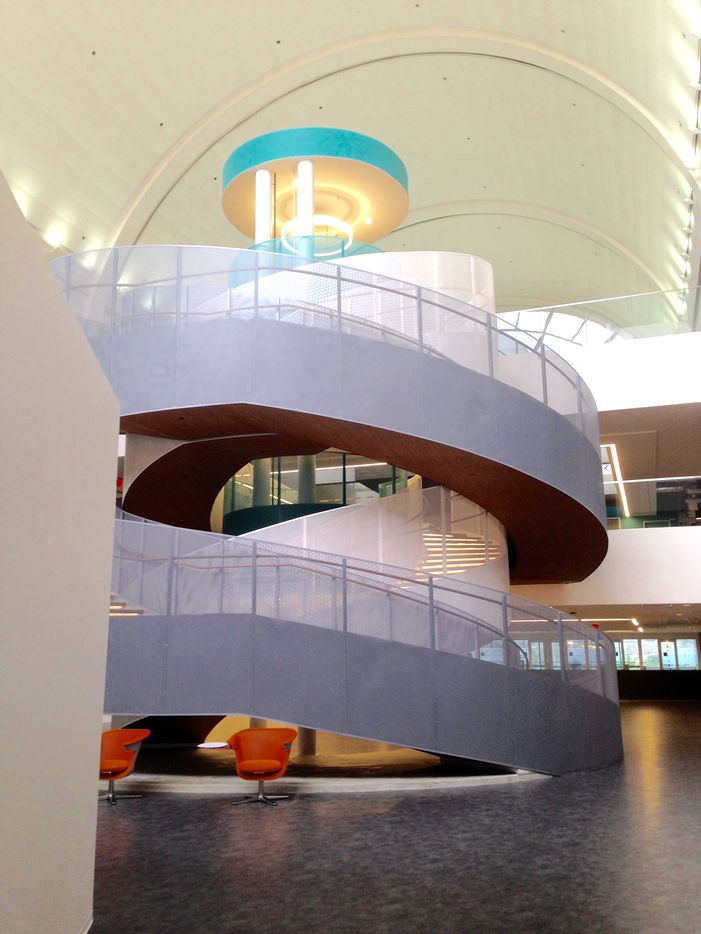 A curved central stair connects the levels of RealPage's Richardson office.