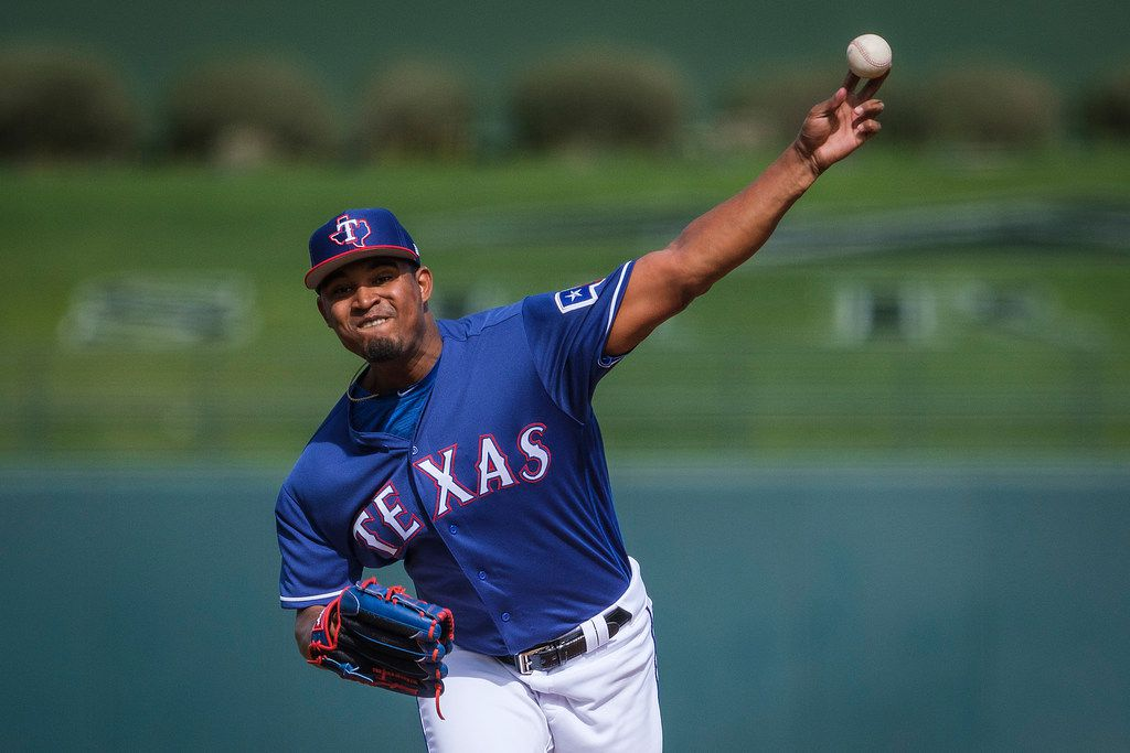Texas Rangers pitcher Yohander Mendez pitches during the first inning of a spring training baseball game against the Milwaukee Brewers at Surprise Stadium on Sunday, Feb. 24, 2019, in Surprise, Ariz.. (Smiley N. Pool/The Dallas Morning News)