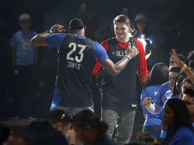 Team LeBron's Los Angeles Lakers LeBron James (23) and Dallas Mavericks forward Luka Doncic (77) meet after player introductions during practice for the NBA All-Star 2020 game at Wintrust Arena in Chicago on Saturday, February 15, 2020.