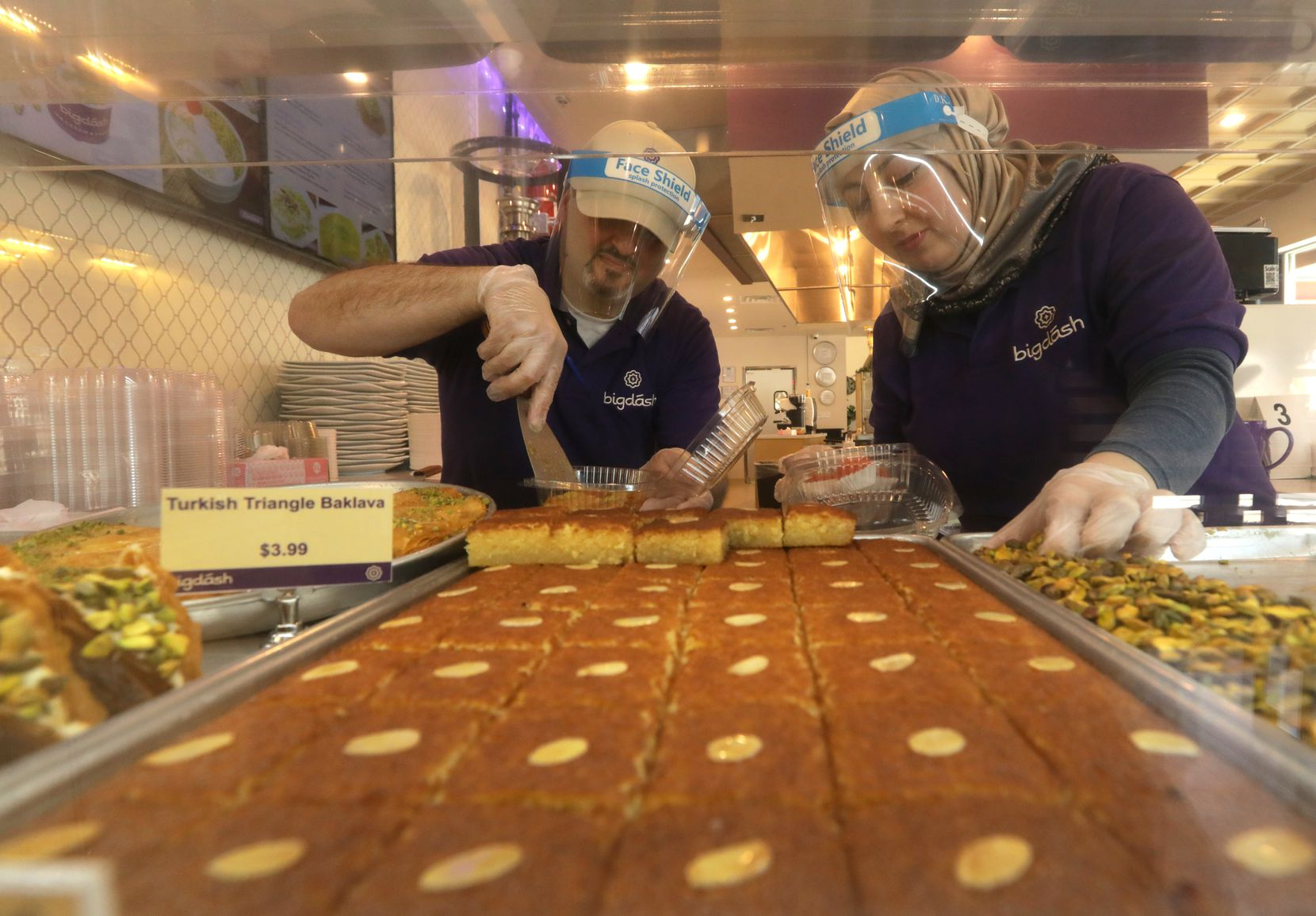 For Kareem Alrefaai (left) and Asmaa Khattab, who own Bigdash, an Arabic ice cream and pastries shop with branches in Richardson and Frisco, Ramadan is one of their busiest times of the year. (Jason Janik/Special Contributor)