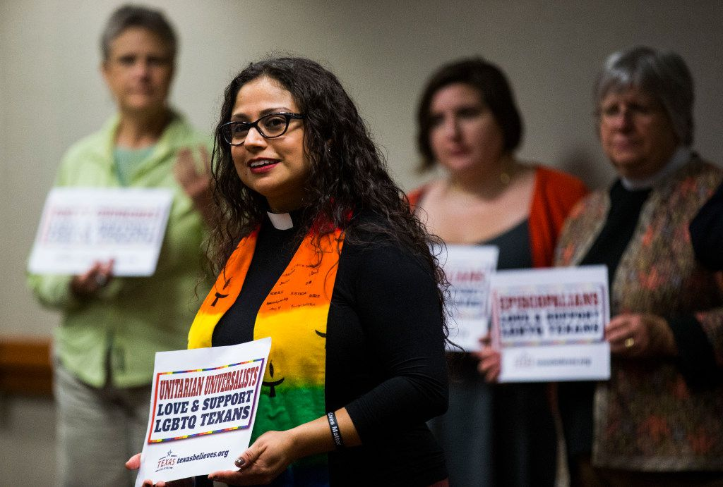 Rev. Marisol Caballero of Austin leads a prayer during an interfaith prayer service in a hospitality room for people who opposed the bathroom bill at a public hearing on the fourth day of a special legislative session on Friday, July 21, 2017 at the Texas state capitol in Austin, Texas. (Ashley Landis/The Dallas Morning News)