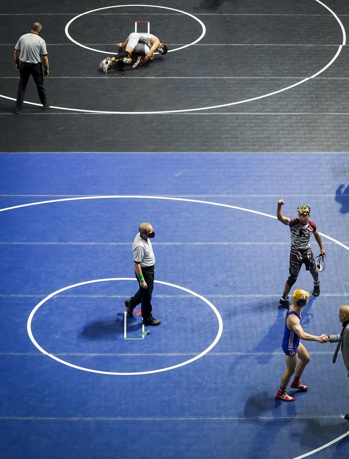 Andres Ugalde of Princeton raises his fist in celebration after defeating Logan Park of Grapevine in the 5A boys 145-pound 5th place match during the UIL State Wrestling tournament at the Berry Center on Friday, April 23, 2021, in Cypress, Texas.