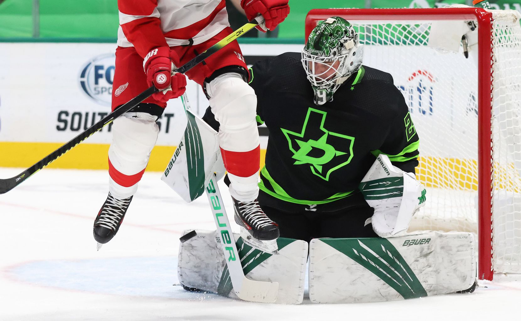 Dallas Stars goaltender Jake Oettinger (29) stops a shot on goal as Detroit Red Wings right wing Bobby Ryan (54) leaps in the air during the second period of play at American Airlines Center on Thursday, January 28, 2021in Dallas. (Vernon Bryant/The Dallas Morning News)