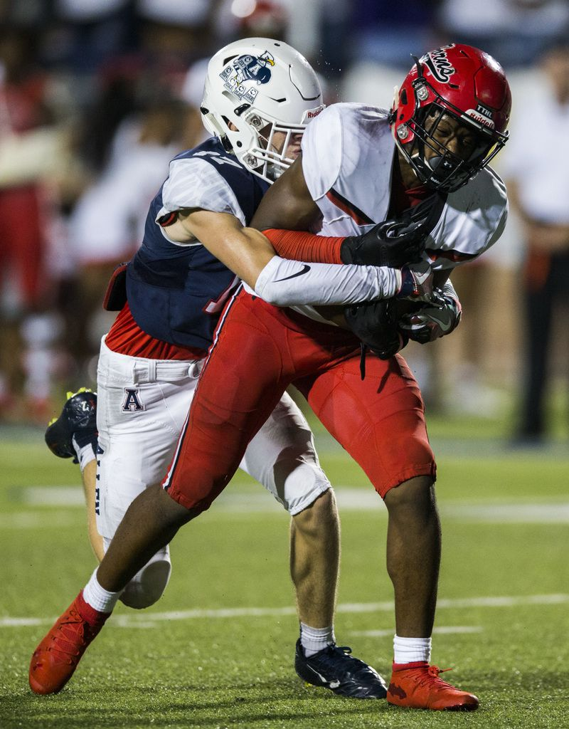 Allen linebacker Jett Waters (17) tackles Cedar Hill running back Corie Allen (10) as Allen makes his way to the end zone for a touchdown during the fourth quarter of a high school football game between Allen and Cedar Hill on Friday, August 30, 2019 at Eagle Stadium in Allen. (Ashley Landis/The Dallas Morning News)