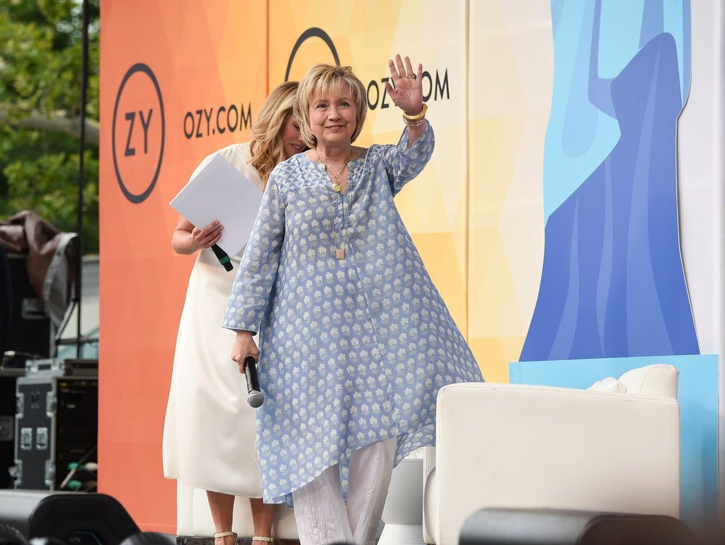 Democratic presidential candidate and former Secretary of State Hillary Rodham Clinton waves to the crowd before a conversation with Laurene Powell Jobs at OZY Fest in Central Park on July 21, 2018, in New York. (Photo by Evan Agostini/Invision/AP)