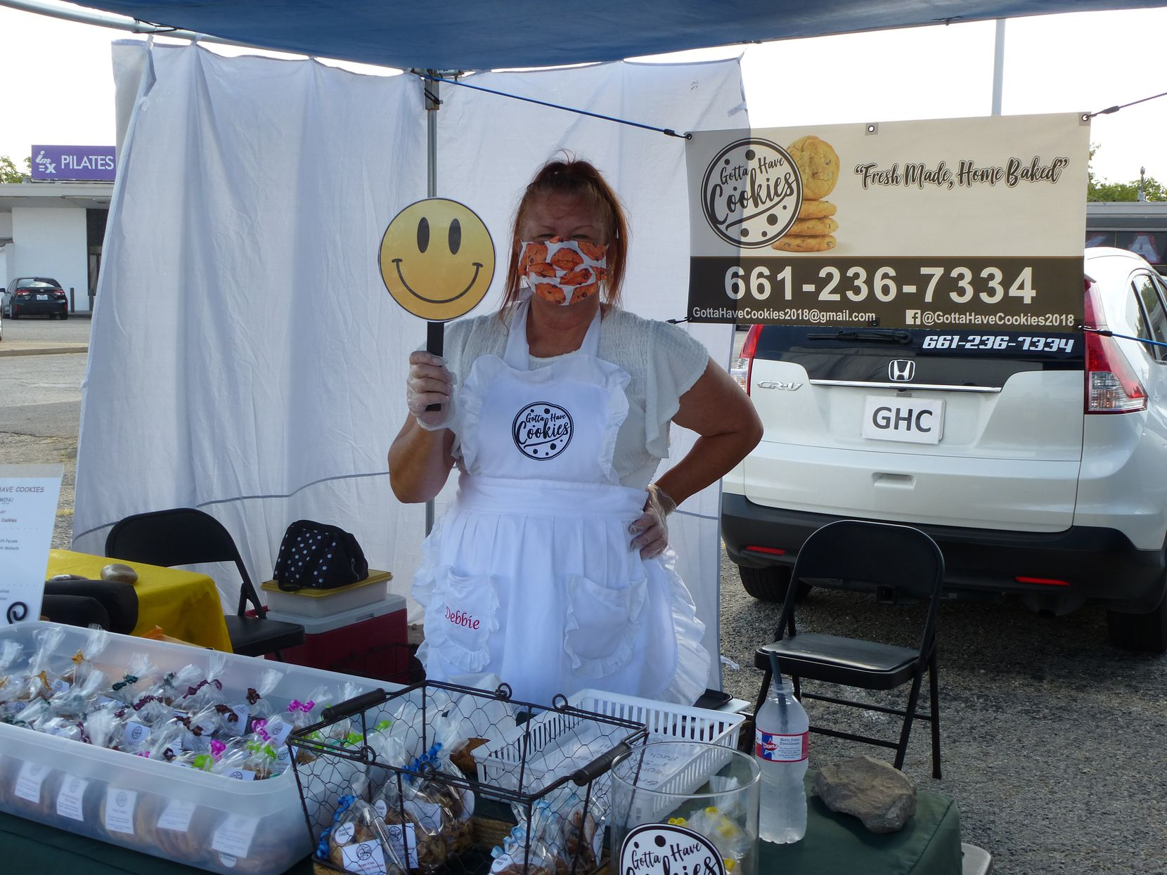 Debbie Zess has a COVID-era smile for everyone at her Gotta Have Cookies table at Cowtown Farmers Market in Fort Worth.