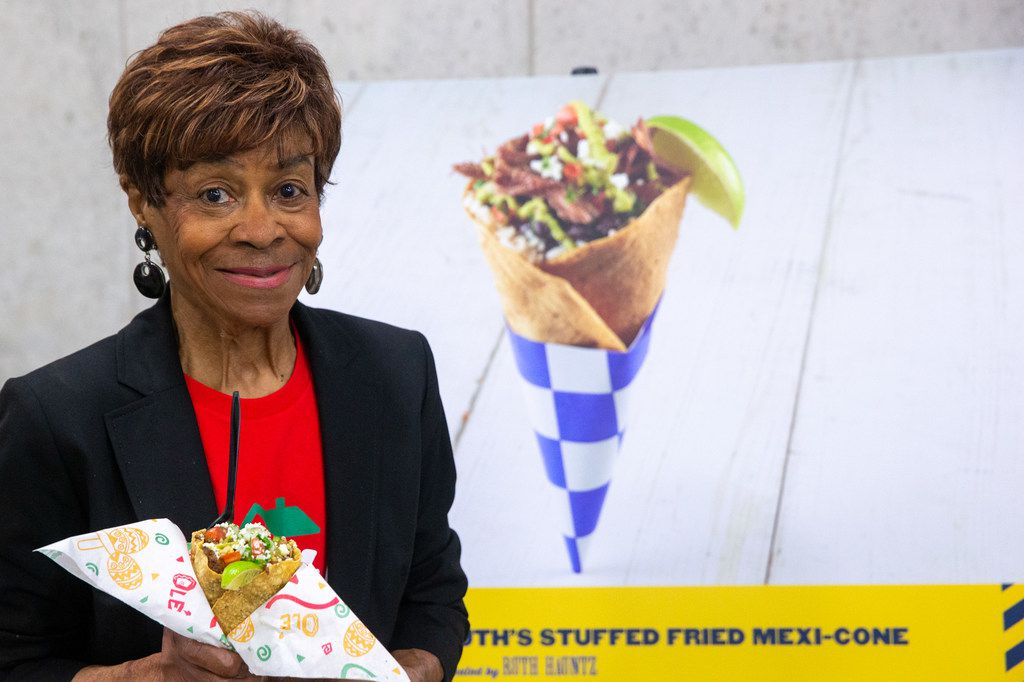 Ruth Hauntz, who is in her eighties and is one of the oldest concessionaires at the State Fair of Texas, is selling her Ruth's Stuffed Fried Taco Cone. Don't miss it.