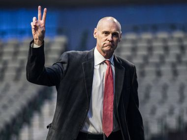 Dallas Mavericks Head Coach Rick Carlisle greets fans at a street signing ceremony honoring retired Dallas Mavericks player Dirk Nowitzki on Wednesday, October 30, 2019 at American Airlines Center in Dallas. The street in front of the arena was renamed Nowitzki Way.