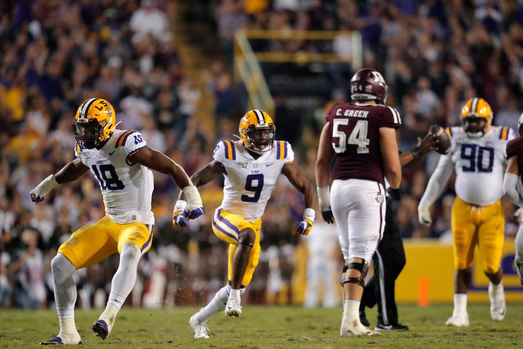 LSU safety Marcel Brooks (9) and linebacker K'Lavon Chaisson (18) celebrate a sack in the first half of an NCAA college football game against Texas A&M in Baton Rouge, La., Saturday, Nov. 30, 2019. (AP Photo/Gerald Herbert)
