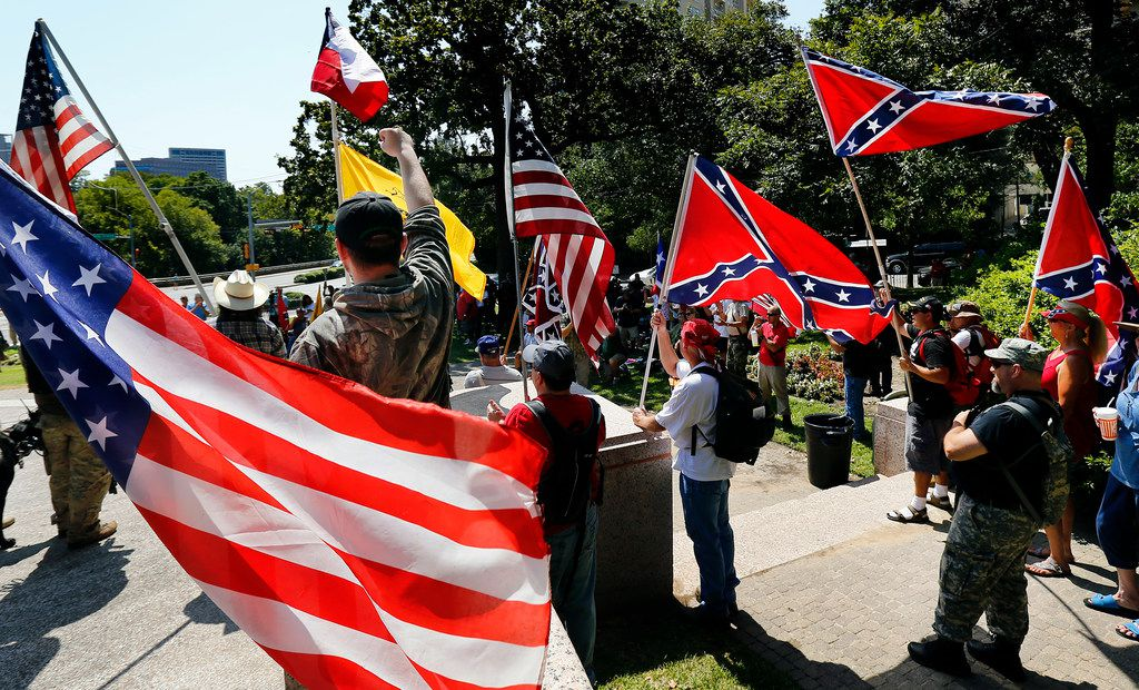 Flag-carrying protesters joined the Texas Freedom Force protest Saturday over removal of the Robert E. Lee statue from Lee Park in Dallas. The statue was removed from Lee Park on Thursday.