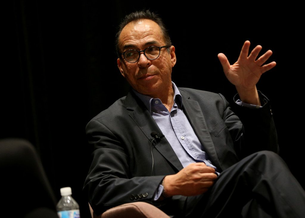 """Dallas Morning News journalist Alfredo Corchado speaks during a discussion with Luisa del Rosal (not pictured), executive director of SMU's Tower Center for Political Studies, on what it's like to grow up in an increasingly multicultural society and the impact of the growing Hispanic population in North Texas during a """"Duets"""" event on June 11, 2018. (Rose Baca/The Dallas Morning News)"""