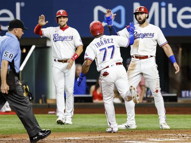 Texas Rangers' Andy Ibanez (77) is congratulated after hitting a three-run home run during the first inning of a baseball game against the Oakland Athletics in Arlington, Monday, June 21, 2021.
