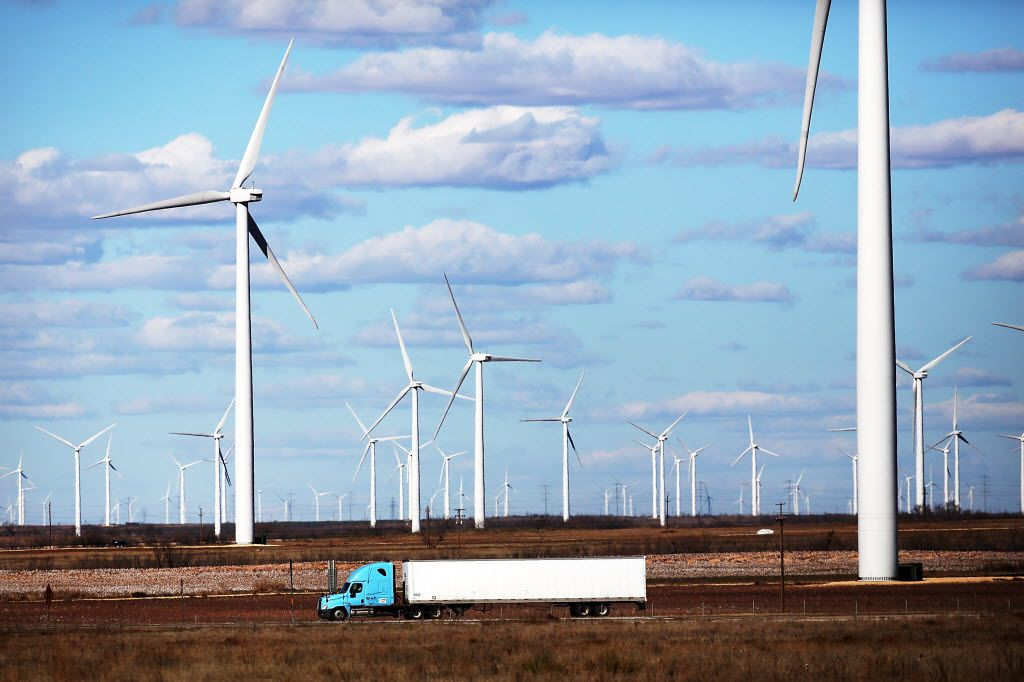 Wind turbines spin at a wind farm in Colorado City, Texas.