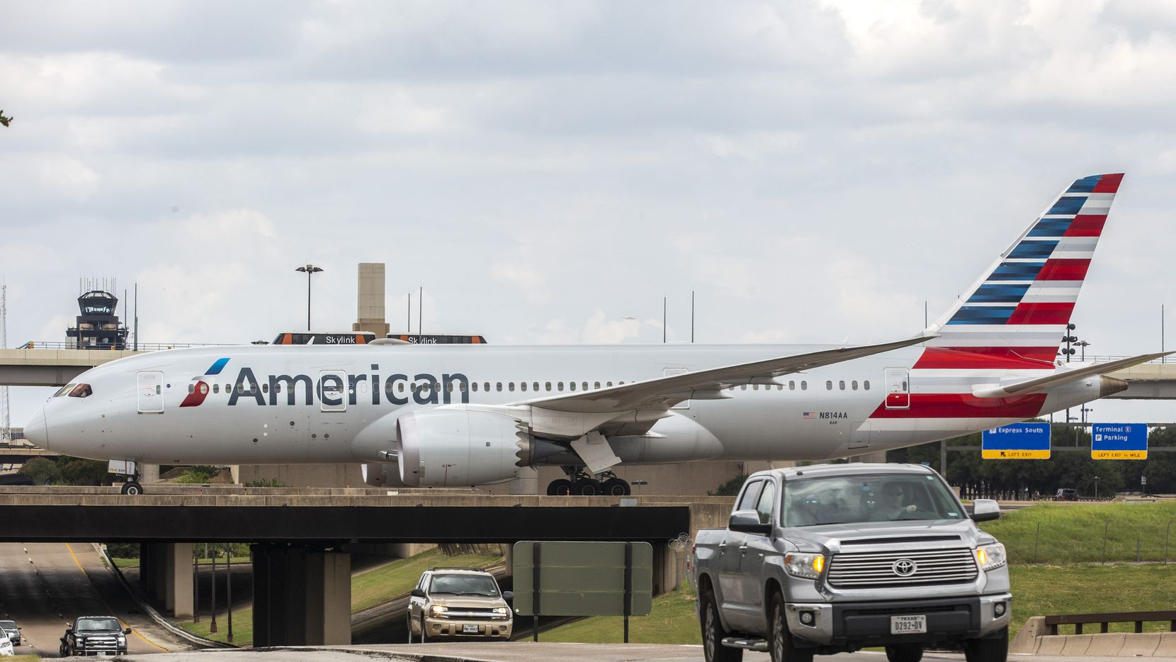 An American Airlines plane coasts the runway at DFW International Airport on Sunday, July 26, 2020.