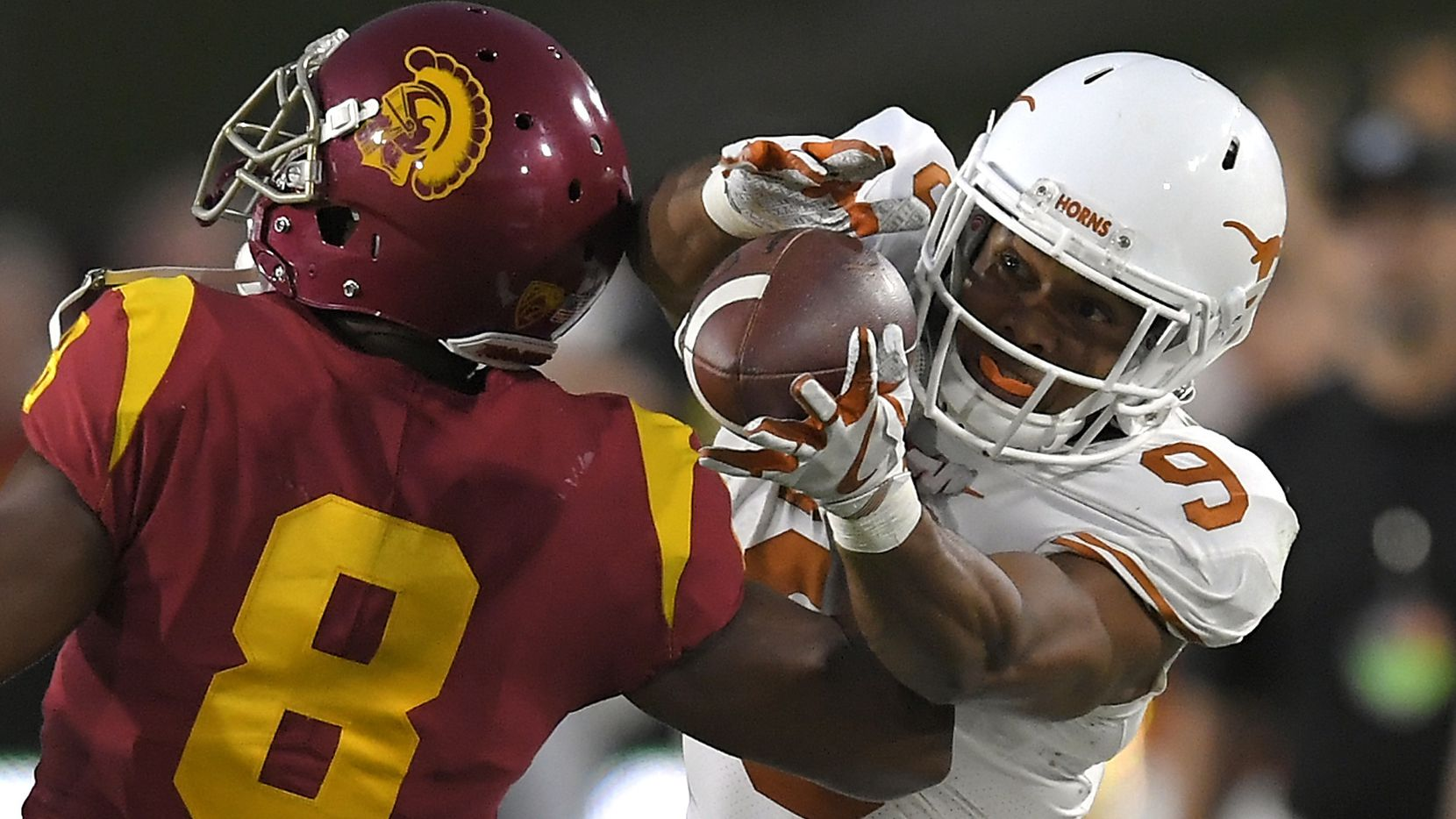FILE - Texas wide receiver Collin Johnson, right, catches a pass as USC cornerback Iman Marshall defends during the first half of Texas' 27-24 double-overtime loss to then-No. 4 USC on Saturday, Sept. 16, 2017, in Los Angeles. Johnson went for 191 receiving yards on seven receptions. (AP Photo/Mark J. Terrill)
