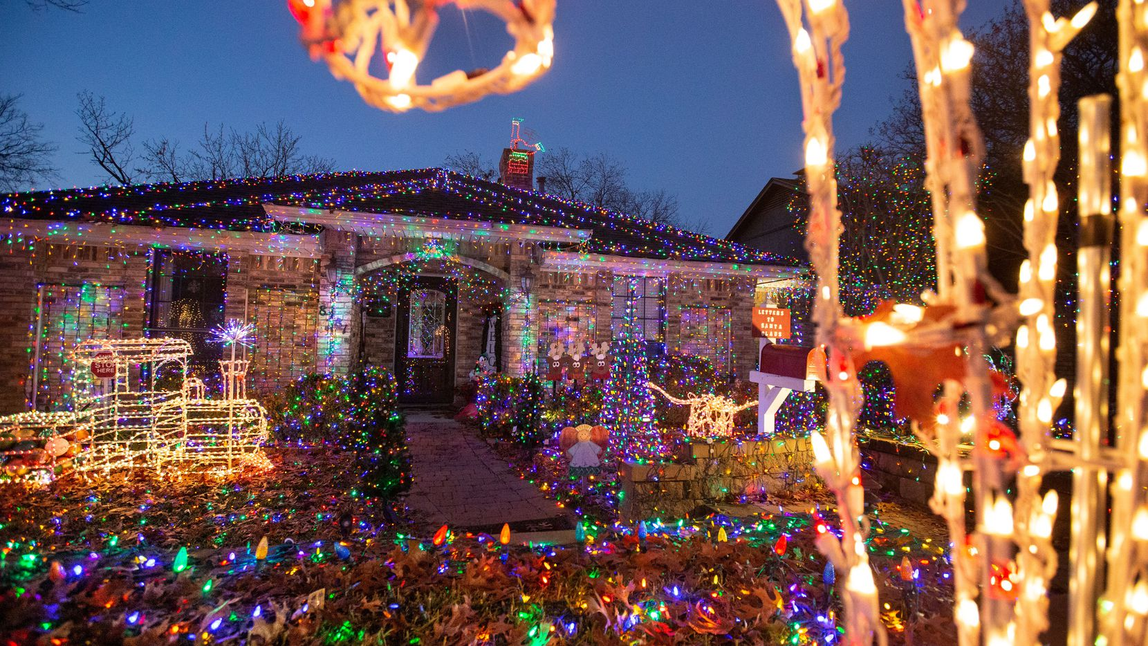 The Lake Highlands home belonging to Jim and Linda Shultz features 37,000 colored lights in Dallas. Jim said the front yard Christmas lights display takes 55 hours to install, and the pair started setting lights up in October. Perhaps the Shultzes or their neighbors will post a photo of their home on The Dallas Morning News members Facebook group this week.