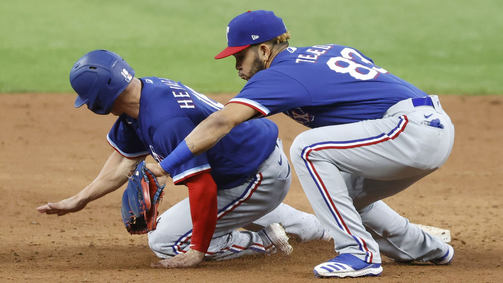 Texas Rangers outfielder Scott Heineman gets back to second safely on a thrown down to infielder Anderson Tejeda from the catcher during a simulated Summer Camp game at Globe Life Field in Arlington, Texas, Thursday, July 9, 2020. (Tom Fox/The Dallas Morning News)