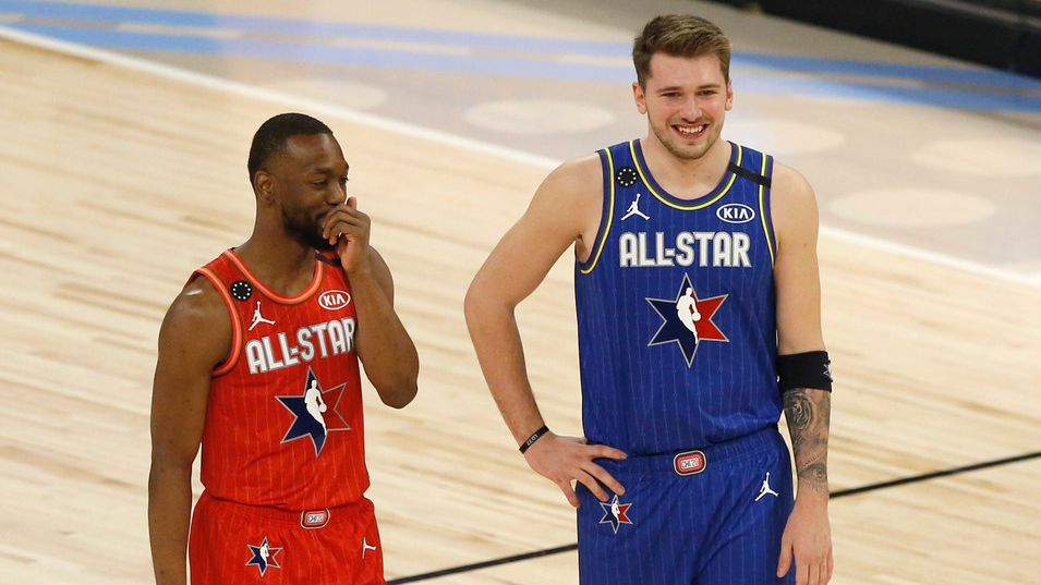 Team LeBron's Luka Doncic (2) and Team Giannis' Kemba Walker (24) share a laugh during a break in play in the second half of play in the NBA All-Star 2020 game at United Center in Chicago on Sunday, February 16, 2020. Team LeBron defeated Team Giannis 157-155.