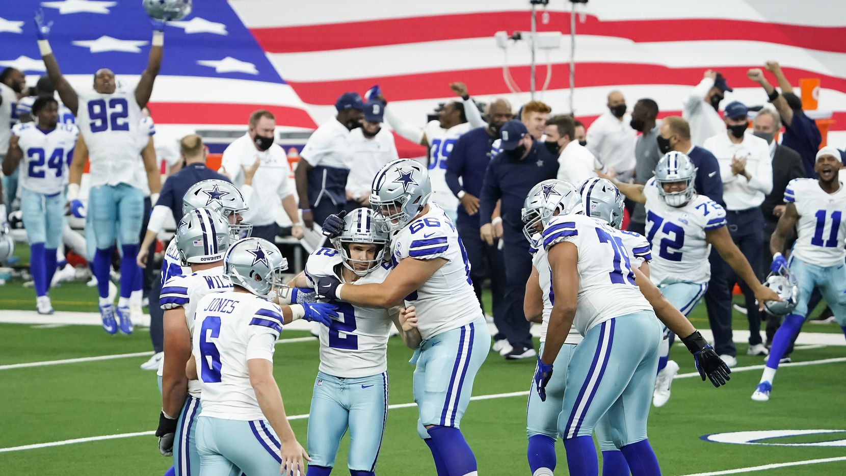 Dallas Cowboys kicker Greg Zuerlein (2) celebrates with Connor McGovern (66) after kicking a 46-yard game-winning field goal on the final play of a 40-39 victory over the against the Atlanta Falcons in an NFL football game at AT&T Stadium on Sunday, Sept. 20, 2020, in Arlington.