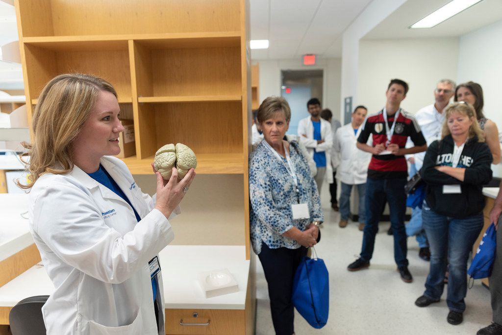 Elizabeth Moody Davenport, Ph.D., asked a group to identify the parts of the brain as they toured the Peter O'Donnell Jr. Brain Institute at UT Southwestern Medical Center on Saturday.