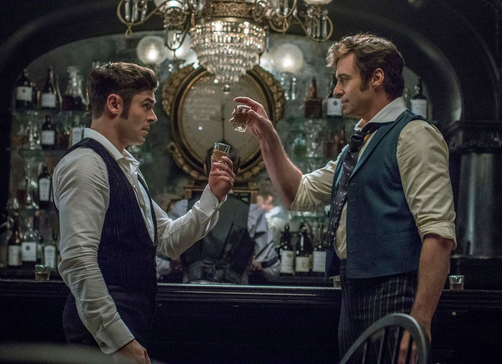"""Zac Efron, left, and Hugh Jackman in a scene from """"The Greatest Showman."""""""