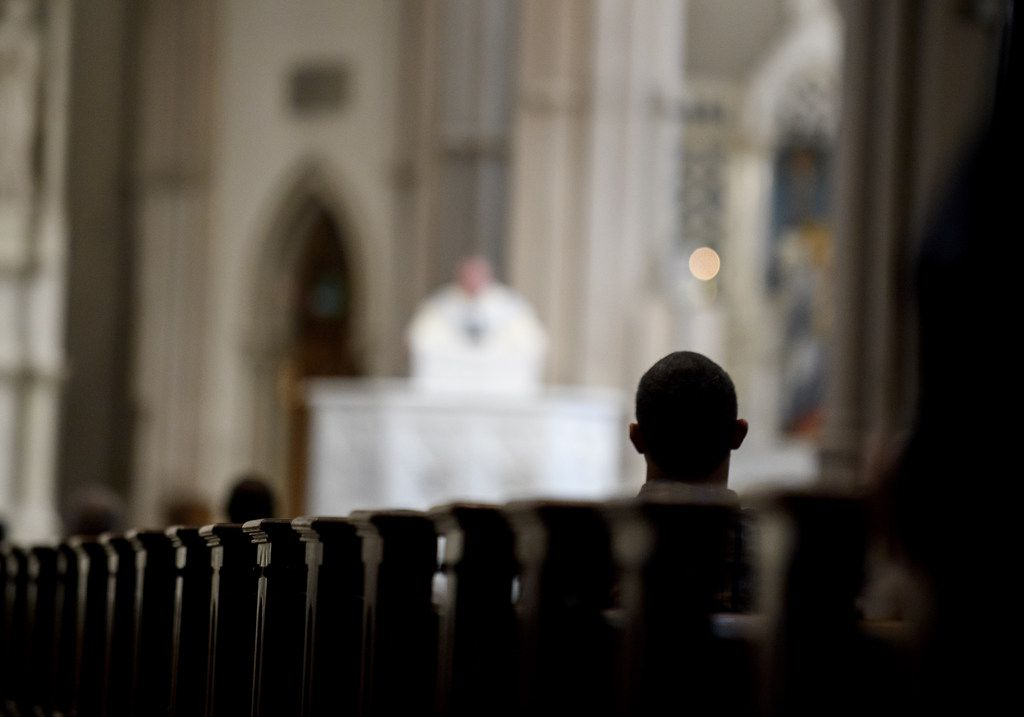 Parishioners worship during a mass to celebrate the Assumption of the Blessed Virgin Mary at St Paul Cathedral, the mother church of the Pittsburgh Diocese in Pittsburgh, Penn.