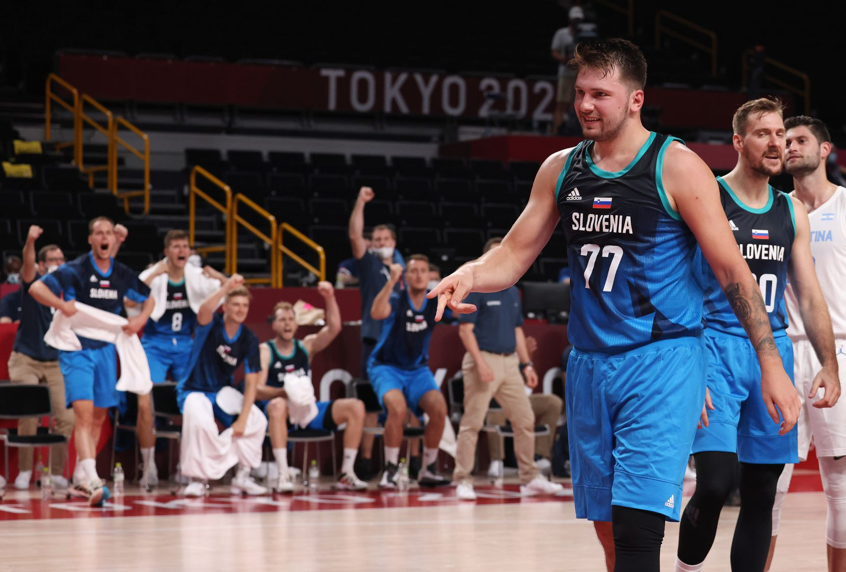 Slovenia's Luka Doncic (77) signals a made basket after he was fouled on a basket in the first half of play against Argentina during the postponed 2020 Tokyo Olympics at Saitama Super Arena on Monday, July 26, 2021, in Saitama, Japan. Slovenia defeated Argentina 118-100. (Vernon Bryant/The Dallas Morning News)
