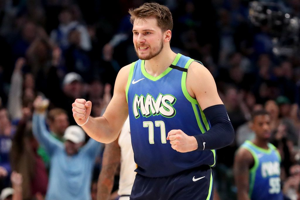 Luka Doncic #77 of the Dallas Mavericks seen here against the Denver Nuggetslast season, was in the starting lineup to begin his third NBA season Saturday as the Mavs opened the preseason in Milwaukee. It was the Mavs' first game in an NBA arena since March 11.