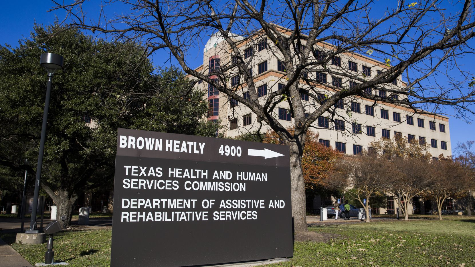Texas' mega agency for health care and social services is rescinding proposed cuts to women's health, family planning and domestic violence programs, it announced Tuesday. But the Health and Human Services Commission, shown in a 2017 file photo, also said it'll commence a hiring freeze for eligibility workers who screen needy Texans applying for safety-net programs, if elected leaders ratify its latest proposal.