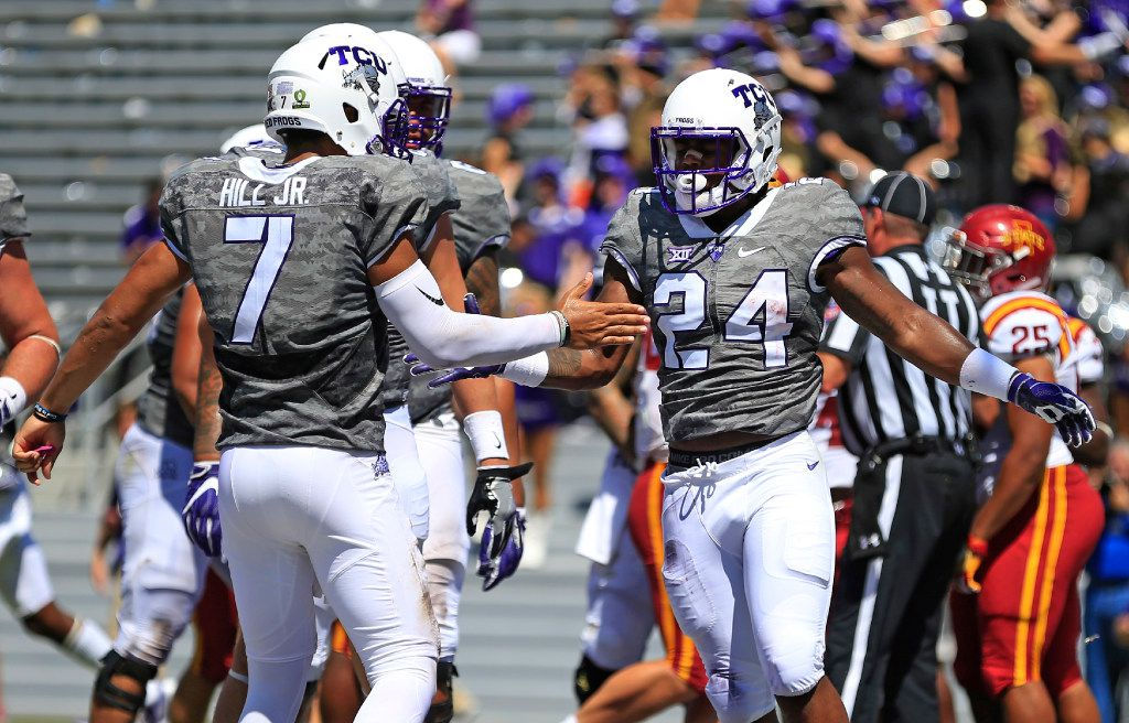 FORT WORTH, TX - SEPTEMBER 17: Trevorris Johnson #24 of the TCU Horned Frogs celebrates with teammates including Kenny Hill #7 of the TCU Horned Frogs after scoring a touchdown against the Iowa State Cyclones during the second half at Amon G. Carter Stadium on September 17, 2016 in Fort Worth, Texas. TCU won 41-20. (Photo by Ron Jenkins/Getty Images)
