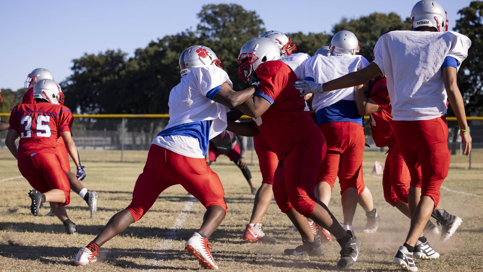 Spruce High School football players practice on Wednesday, Sept. 22, 2021, at H. Grady Spruce High School in Dallas. (Juan Figueroa/The Dallas Morning News)