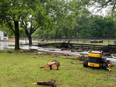 The aftermath of a flash flood through Mill-Again Stables included broken fences and flooded facilities.
