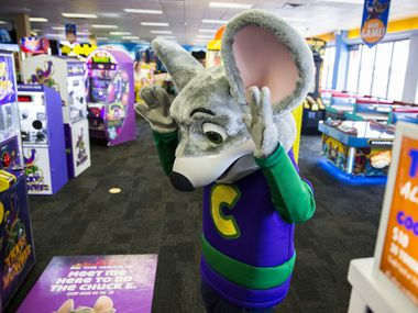 Chuck E Cheese dances with children at Chuck E Cheese on Wednesday, April 8, 2015 in Irving, Texas.  (Ashley Landis/The Dallas Morning News)