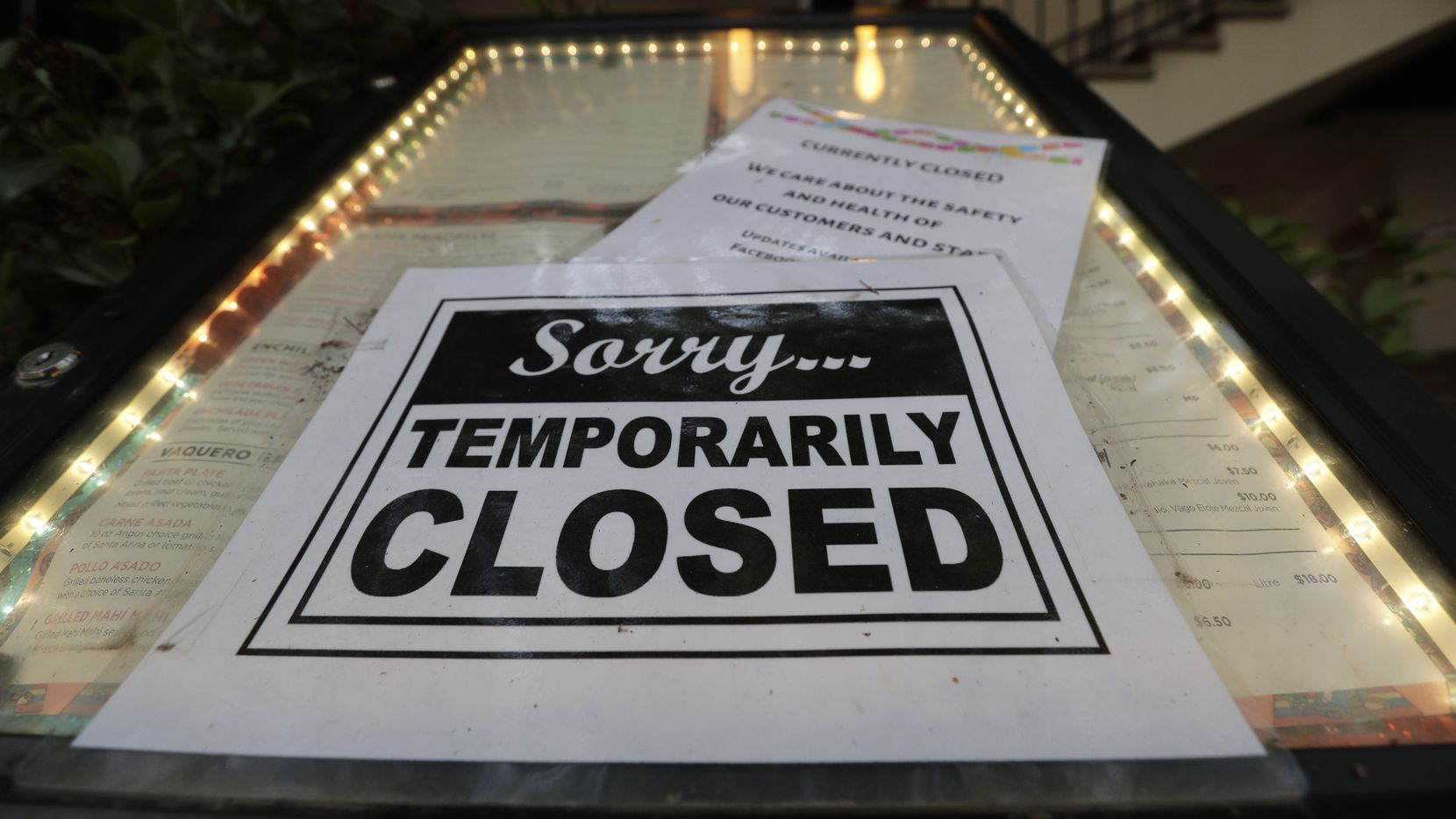 A closed sign is posted at a restaurant along the River Walk in San Antonio, Tuesday, April 28, 2020. Texas Gov. Greg Abbott is allowing Texas' stay-at-home orders to expire this week and easing restrictions on non-essential business and restaurants can open for seating with 25 percent capacity.