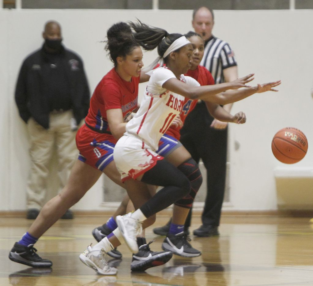 Mesquite Horn guard Asiya Sabr (11) reaches for a loose ball as she is challenged by Duncanville defenders Laila McLeod (22), left, and Kaila Kelley(14) during first half action. Duncanville won 82-52 to advance. The two teams played their Class 6A area-round playoff basketball game at Loos Field House in Addison on February 23, 2021. (Steve Hamm/ Special Contributor)