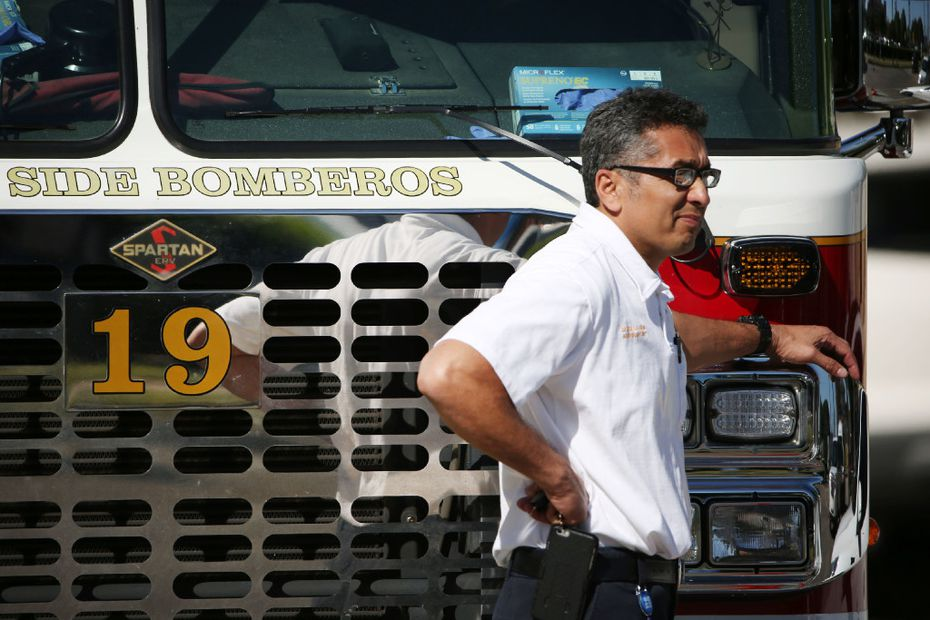 Personnel leans on Dallas Fire-Rescue engine 19 outside of the Baylor University Medical Center at Dallas emergency room after a Dallas Fire-Rescue paramedic was transported their after being shot on Monday.