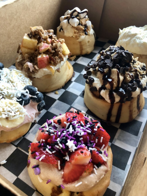 Cinnaholic's signature rolls include the sparkle berry, cookie monster, old skool. tropical bliss, caramel apple pie and campfire s'mores.