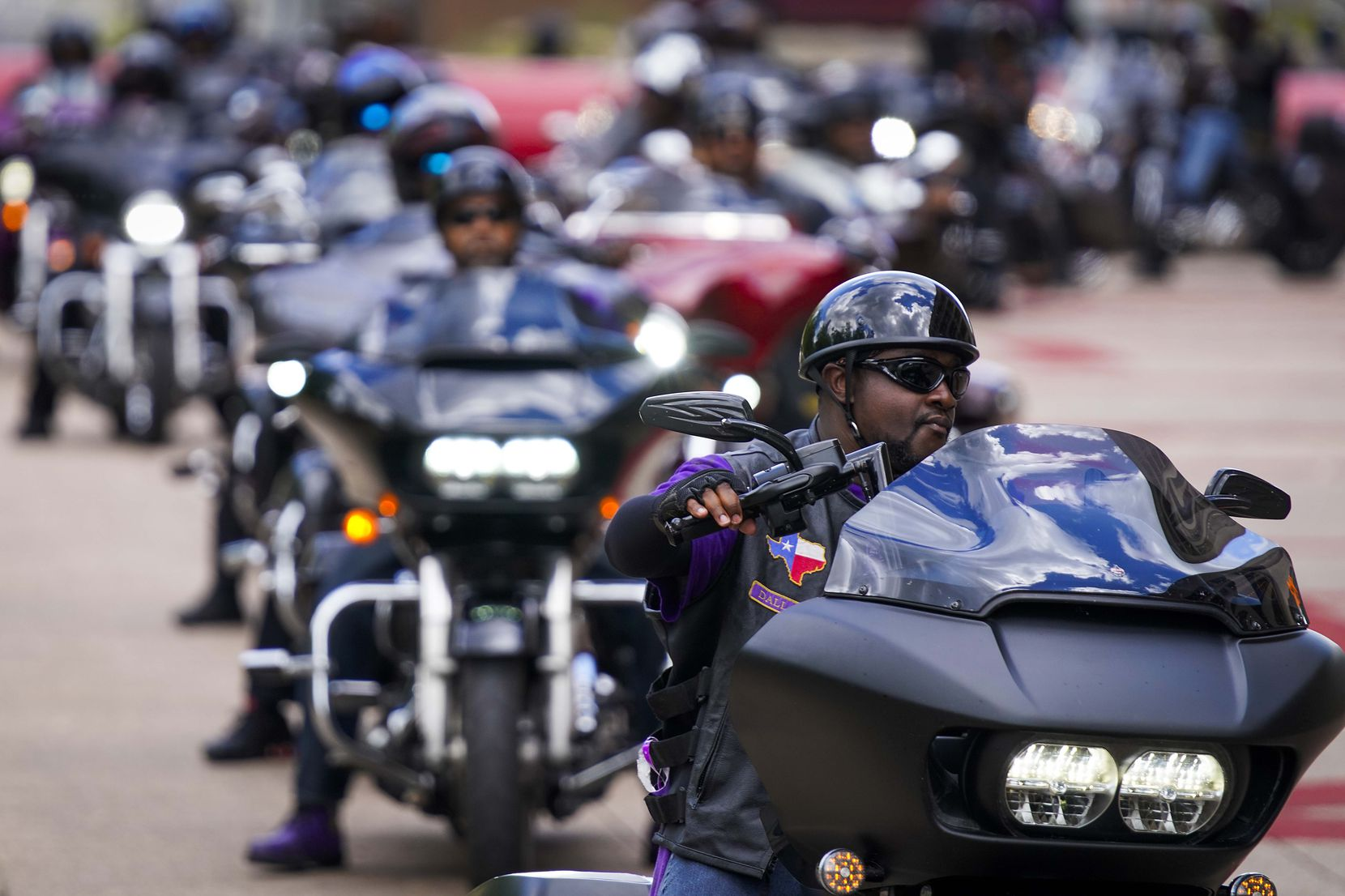 A group of more than 400 bikers arrives at Dallas City Hall during a ride and rally commemorating Juneteenth on Friday, June 19, 2020.