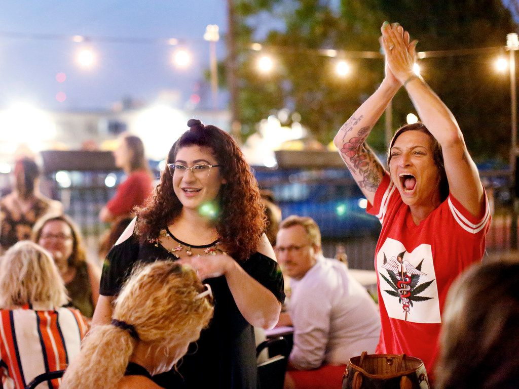Leslie Collum, right, a registered nurse, and several hundred supporters of State Question 788 celebrate the passage of the medical marijuana initiative at a watch party at the Speakeasy, Tuesday, June 26, 2018, in Oklahoma City. State Question 788 was the result of an activist-led signature drive. (Jim Beckel/The Oklahoman via AP)