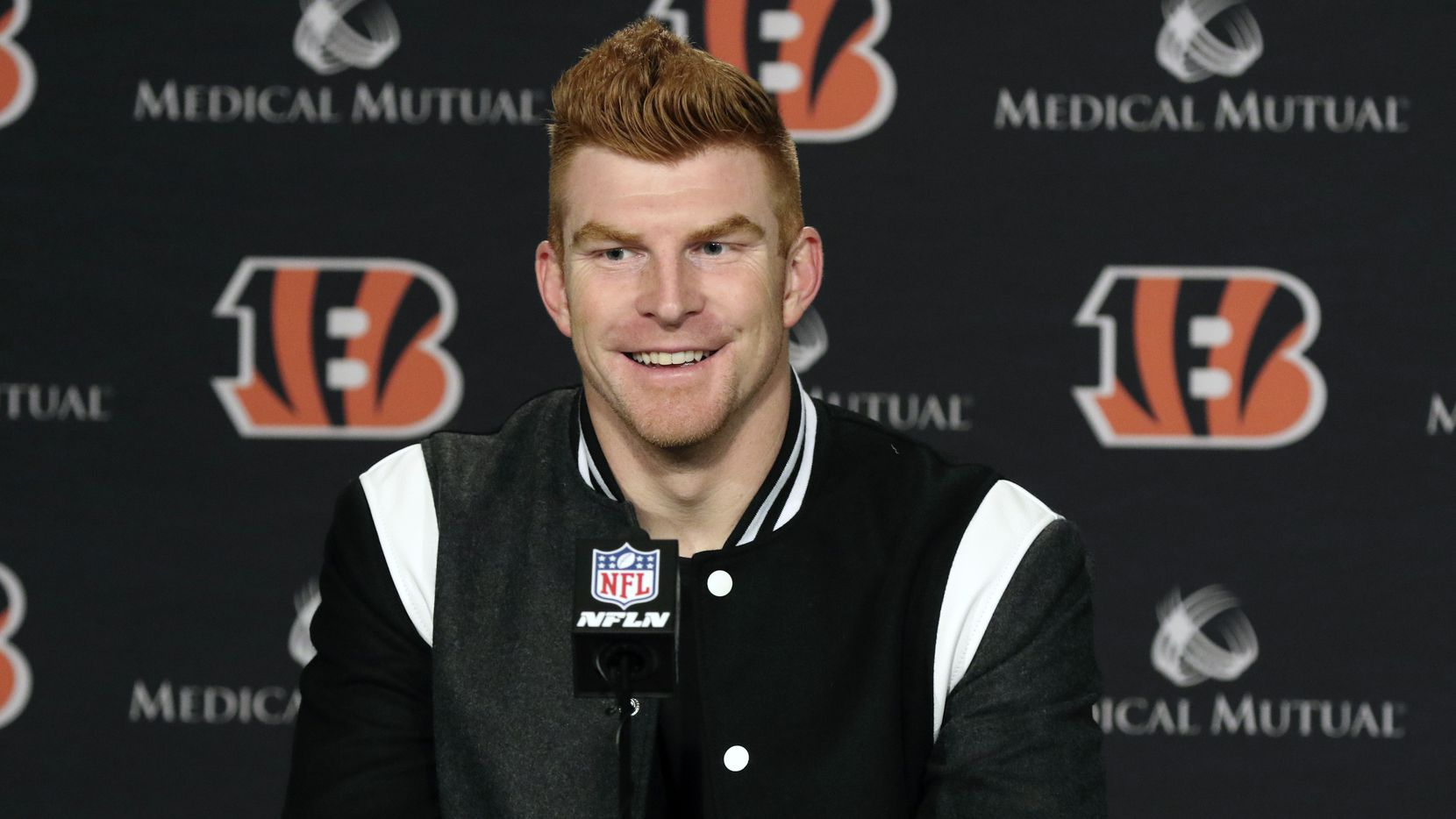 In this Dec. 29, 2019, file photo, Cincinnati Bengals quarterback Andy Dalton answers questions after his team defeated the Cleveland Browns in an NFL football game in Cincinnati. Dalton is coming home to Texas as Dak Prescott's backup with the Dallas Cowboys.