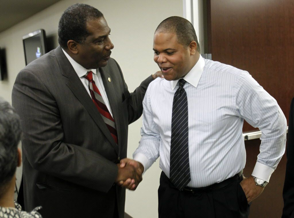 Rep. Eric Johnson (right), D-Dallas is congratulated by State Sen. Royce West at a lunch at the Texas Hospital Association in Austin. (Vernon Bryant/The Dallas Morning News)