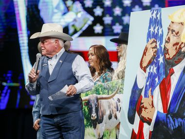 Texas Agriculture Commissioner Sid Miller calls an auction for a painting of former president Donald Trump at the Conservative Political Action Conference on Sunday, July 11, 2021, in Dallas. (Elias Valverde II/The Dallas Morning News)