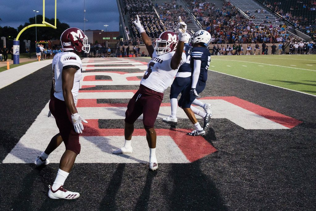 Mesquite running back LaDarius Turner (4) celebrates with wide receiver K.B. Frazier (5) after scoring on a 36-yard touchdown run during the first half of a high school football game against L.D. Bell on Thursday, Sept. 19, 2019, in Bedford, Texas. (Smiley N. Pool/The Dallas Morning News)