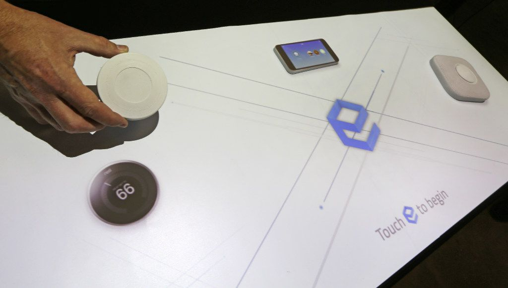 Spacee's technology can turn the surface of a car, table or display case into an interactive touch screen. In this display, a projector can make plastic shapes look like a smart thermostat or an iPhone. The display mimics the look and function of a product, without the need for security devices or risk of theft. (Louis DeLuca/The Dallas Morning News)
