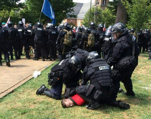 In this twitter hand-out photo courtesy the Virginia State Police Arrests are being made following declaration of unlawful assembly at Emancipation Park in Charlottesville, Virginia on August 12, 2017. A picturesque Virginia city braced Saturday for a flood of white nationalist demonstrators as well as counter-protesters, declaring a local emergency as law enforcement attempted to quell early violent clashes.