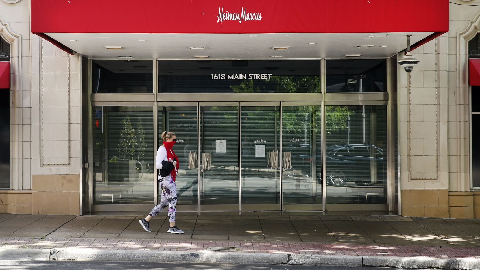 Closed signs appear on the doors of Neiman Marcus' flagship store in downtown Dallas on April 19.