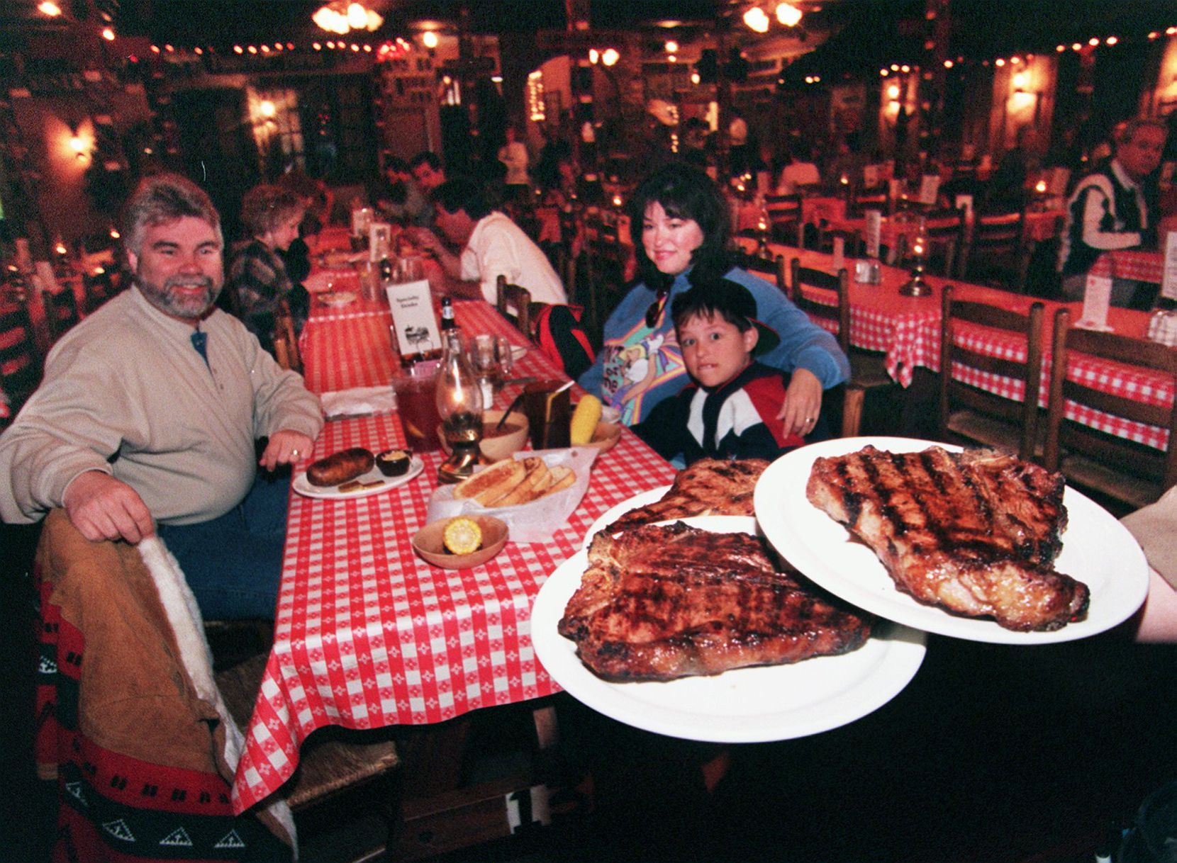Tom, Irene and then-7-year-old Chase Massar were ready for their Cowboy steaks at Trail Dust Steak House in Mesquite in this 1997 file photo.