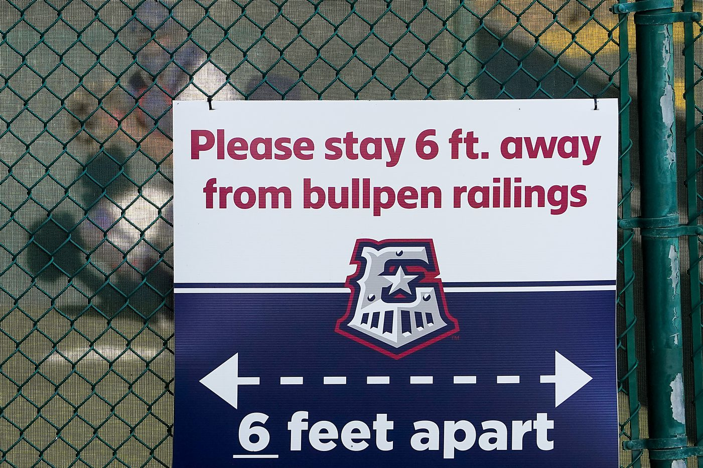 Signs at Dell Diamond encourage fans to keep social distancing from the bullpen before the Round Rock Express season opener against the Oklahoma City Dodgers on Thursday, May 6, 2021, in Round Rock, Texas. It was the first gamer for the Express in 601 days due to the COVID-19 pandemic.