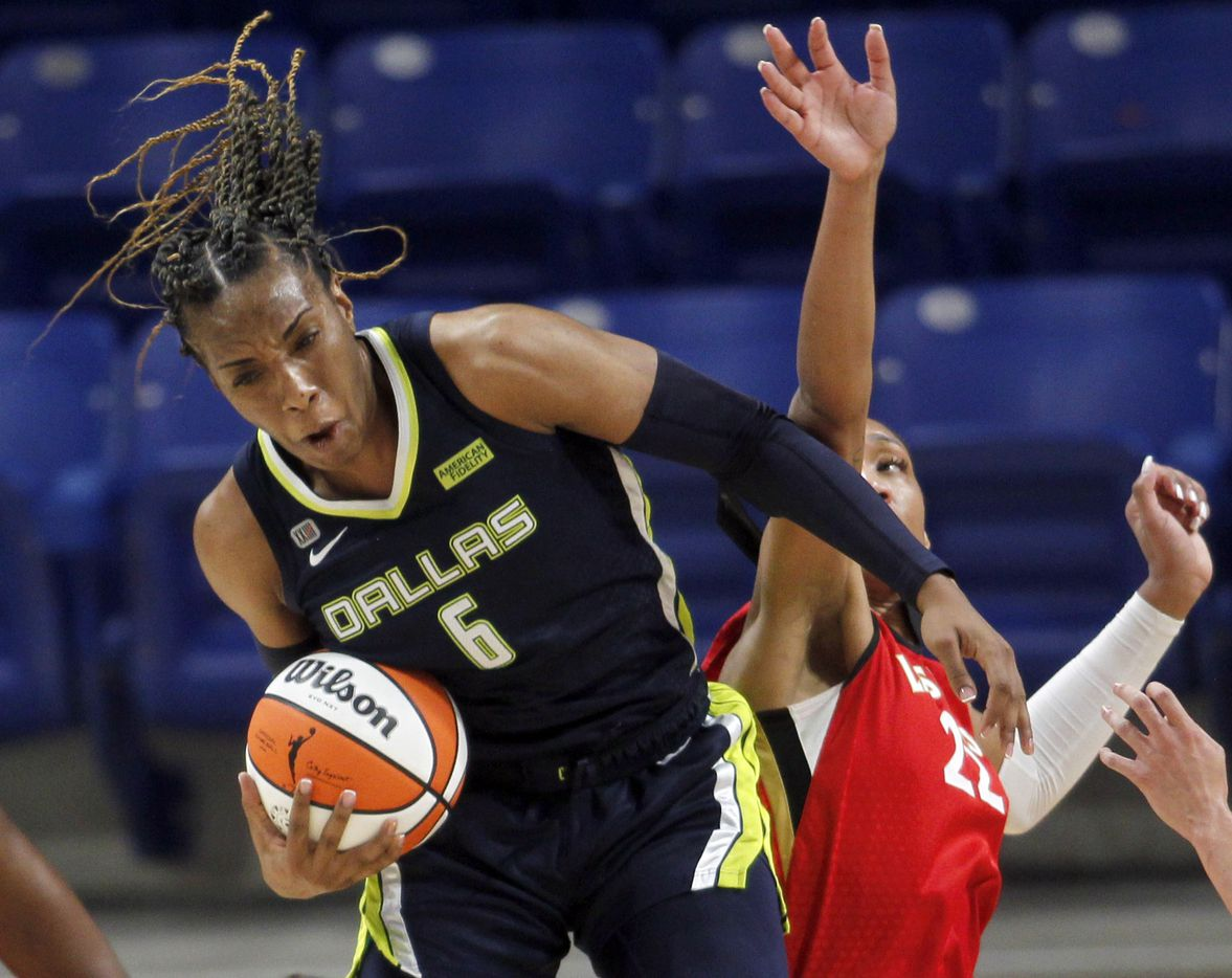 Dallas Wings forward Kayla Thornton (6) comes down with a rebound as she is challenged by Las Vegas forward A'ja Wilson (22) during second half action. Las Vegas defeated Dallas 95-79. The two WNBA teams played their game at College Park Center on the campus of UT-Arlington on July 11, 2021. (Steve Hamm/ Special Contributor)